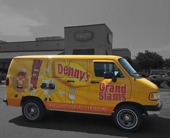 A van wrapped with fun graphics to advertise Denny's Restaurant